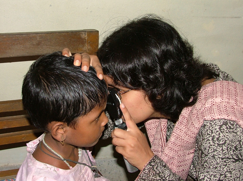 Child identified as being blind by a key informant in Bangladesh being examined by an ophthalmologist in the temporary clinic set up in the community
